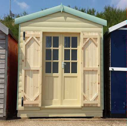 Beach hut with internal glazed doors