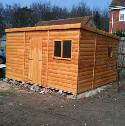 large rubber roofed cube shed